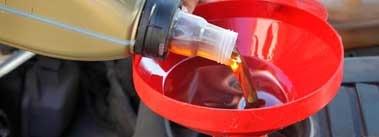 Pouring Automotive Oil