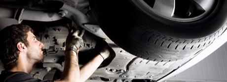 Technician repairing 4 wheel drive
